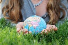 Terra à mão Fotografia de Stock