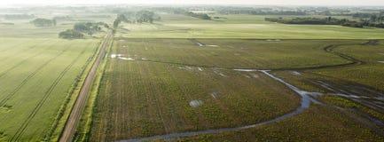 Terra acquosa dell'azienda agricola del Sud Dakota Fotografia Stock
