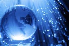 Terra & ottica delle fibre Fotografia Stock