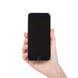 A terra arrendada da mulher isolou o cinza novo do espaço do iPhone 6 do telefone Imagens de Stock