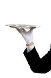 Terra arrendada de braço dos empregados de mesa uma bandeja do serviço Imagem de Stock Royalty Free