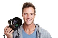 Terra arrendada feliz do fotógrafo digital imagens de stock royalty free