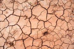Terra asciutta, disastro del mondo, suolo rotto, fondo al suolo incrinato fotografia stock