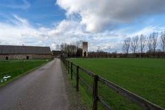 Terra cênico com exploração agrícola e a torre velha Fotografia de Stock Royalty Free