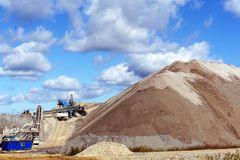 Terra-cone with belt conveyor system. Dumps of mined rock with a system of belt conveyors and stackers, general view royalty free stock photo
