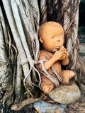 Terra cotta doll. Old terracotta doll cobine into tree Stock Images