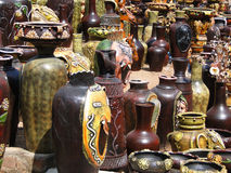Terra cotta pottery in traditional designs Stock Images
