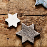 Terra Cotta stars. On aged wooden background for christmas concept Royalty Free Stock Photo