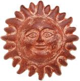 Terra cotta sun face. Isolated on white Stock Image
