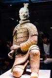 Terra-cotta warriors in Xian, China. All the terra-cotta warriors in the pit held bronze weapons. The main ones are crossbows, arrow heads, spears, dagger-axes royalty free stock photo