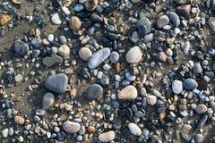 A terra da pedra da praia fotos de stock