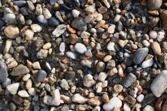 A terra da pedra da praia fotografia de stock royalty free