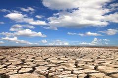 Terra da seca contra Imagem de Stock Royalty Free