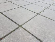 Terra de cinzas portuguesas das pedras na cidade de Storkow foto de stock