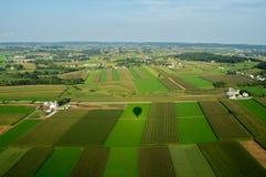 Terra de exploração agrícola de cima de Imagem de Stock Royalty Free