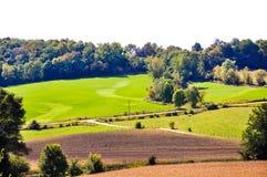 Terra de exploração agrícola produtiva de Iowa Imagens de Stock