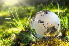 Terra de vidro em gras imagem de stock royalty free