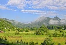 Terra dell'azienda agricola in una valle Immagine Stock Libera da Diritti