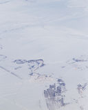 Terra di Snowy Vista dall'aeroplano Immagine Stock Libera da Diritti