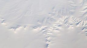 Terra di Snowy Vista dall'aeroplano Immagini Stock