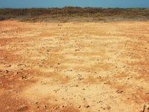 Terra do deserto com areia e pedras Fotografia de Stock