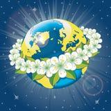 Terra do planeta com a grinalda de flovers da mola. Vista franco Fotos de Stock