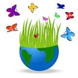 Terra do planeta e borboletas brilhantes em um fundo branco Foto de Stock