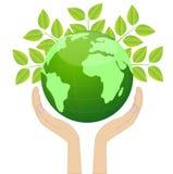 Terra do planeta nas mãos Imagens de Stock