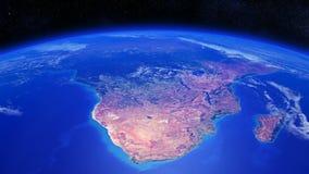 Terra do planeta que gira sobre a África meridional com nuvens claras Imagens de Stock