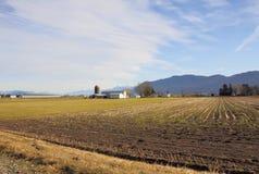 Terra dormiente dell'azienda agricola di inverno Fotografia Stock Libera da Diritti