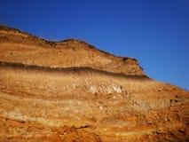 Terra e céu alaranjados Fotografia de Stock