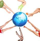 Terra e pés Imagens de Stock Royalty Free
