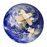 Terra ferita con bandaid Immagini Stock Libere da Diritti