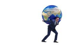 A terra levando do homem de negócios em seus ombros Fotos de Stock Royalty Free
