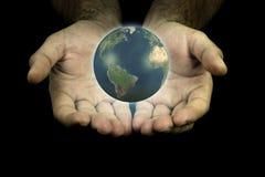 Terra in mie mani Immagine Stock Libera da Diritti