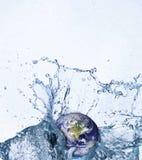 Terra na água Foto de Stock Royalty Free