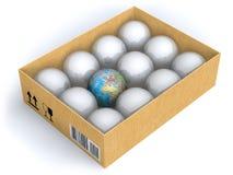 Terra na caixa com esferas Fotografia de Stock