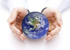 Terra nel backgorund delle mani? creato in ps? Fotografie Stock Libere da Diritti