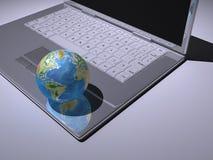 Terra no portátil Imagens de Stock