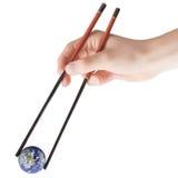 Terra nos chopsticks fotografia de stock