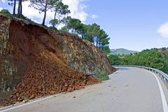 Terra ou aluvião na estrada da montanha após a tempestade fotos de stock royalty free