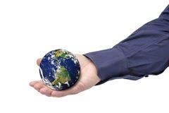 Terra que guarda o homem de negócios Isolated da mão Imagens de Stock Royalty Free