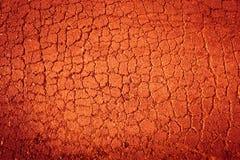 Terra rachada encarnado fundo Textured Imagem de Stock Royalty Free