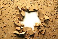 Terra rachada secada foto de stock