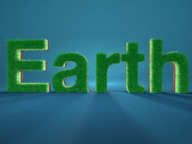 A terra soletrou pelas letras feitas da grama verde fresca no backg azul Imagem de Stock