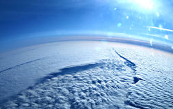 Terra sopra dalle nubi Immagine Stock Libera da Diritti