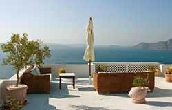 On the terrace. The terrace with a view over caldera of Santorini, Greece Royalty Free Stock Photos