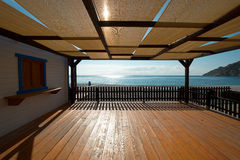Terrace. A wooden terrace with views on the sea royalty free stock photo