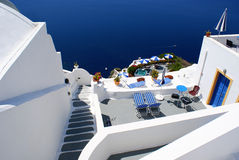 Terrace. With chairs and umbrellas on Santorini island, Greece stock images
