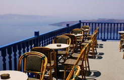 Terrace. Coffee time on terrace in Santorini island, Greece royalty free stock images